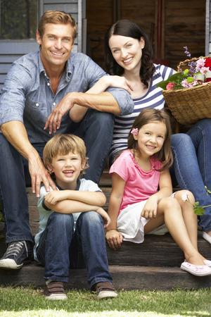 Family sitting  on veranda photo