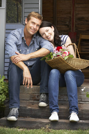 Couple sitting  on veranda photo