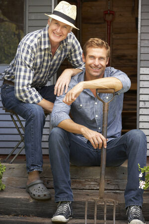 mid adult men: Adult father and son on veranda