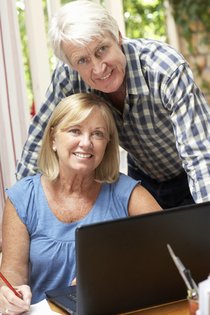 Senior Couple Working In Home Office photo