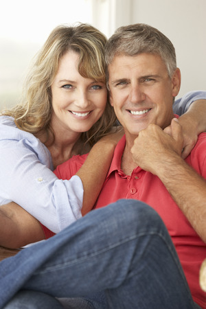 greying: Mid age couple at home
