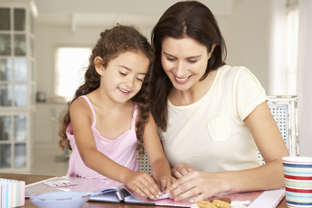 Mother and daughter scrapbooking