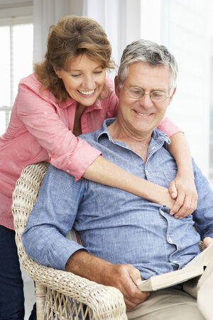 Senior couple relaxing at home photo
