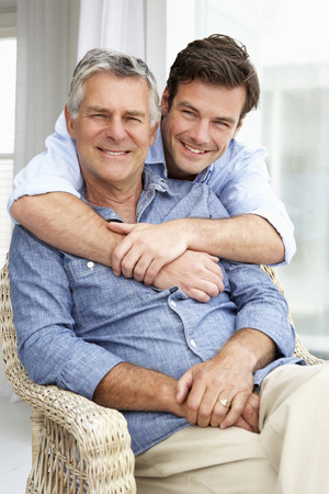 Adult father and son relaxing at home Stockfoto