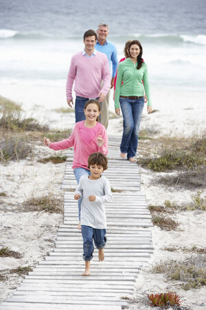Family walking by the sea photo