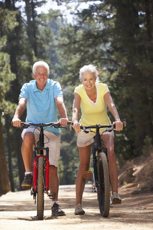 vertical: Senior couple on country bike ride