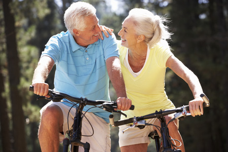 man outdoors: Senior couple on country bike ride