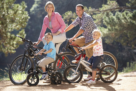 cycle ride: Young family on country bike ride Stock Photo