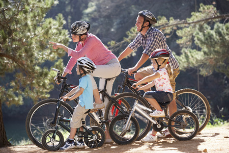 Young family on country bike ride photo