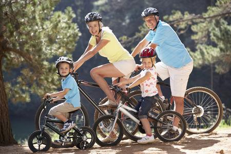 granny and grandad: Senior couple with grandchildren on country bike ride Stock Photo
