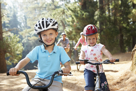 men 45 years: Young family on country bike ride Stock Photo