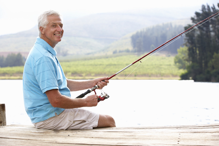 older men: Senior man fishing on jetty