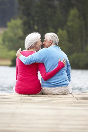 africa kiss: Romantic senior couple sitting on a jetty