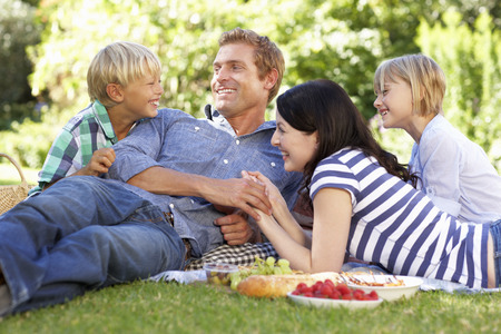 Family with picnic in park Stock Photo