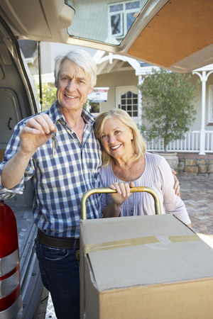 Senior couple moving house photo