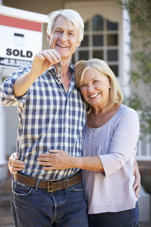 middle age couple: Senior couple moving house Stock Photo
