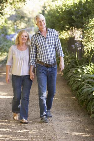 active couple: Senior couple on country walk Stock Photo