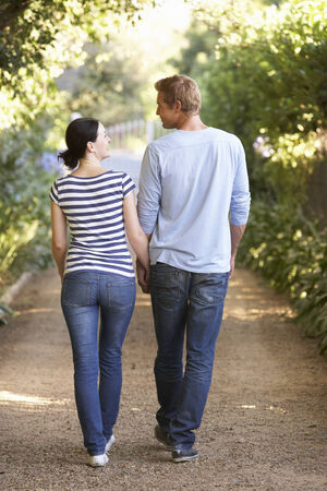 mid adult couple: Couple on country walk Stock Photo