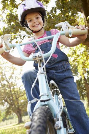 Little girl on bike photo