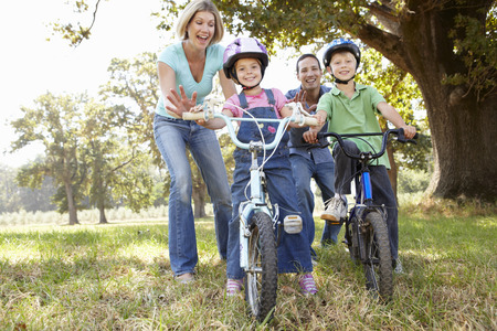 Parents with young children on bikes photo