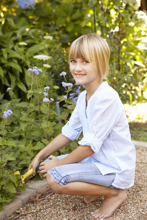 7 year old girl: Young girl gardening Stock Photo