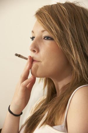 Teenage girl smoking Stock Photo
