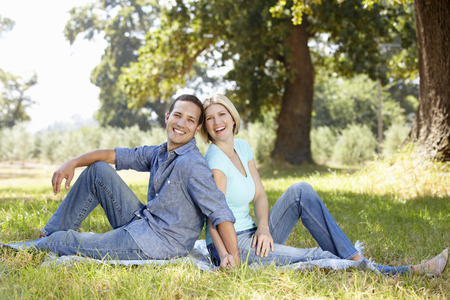 sitting on the ground: Couple in the country Stock Photo