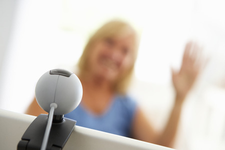 skype: Senior woman using skype