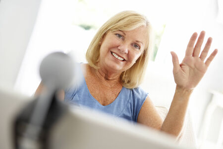 Senior woman using skype