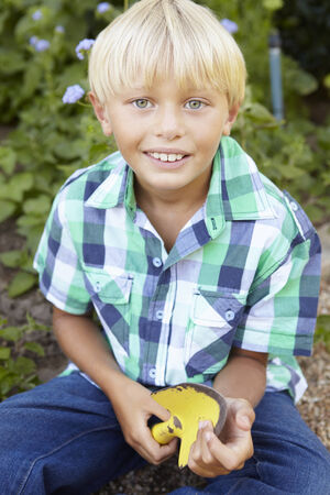 Young boy gardening photo
