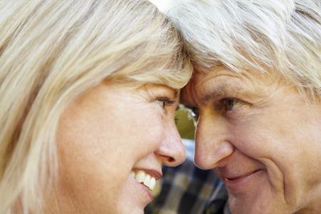 happily: Senior couple outdoors Stock Photo