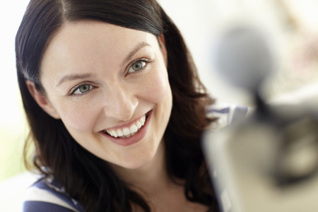 skype: Woman using skype Stock Photo