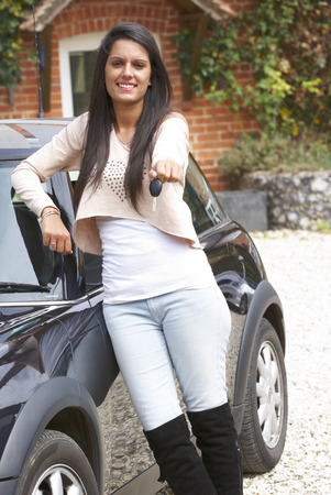 Young woman with car photo