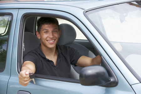 boy 18 year old: Young man in car Stock Photo