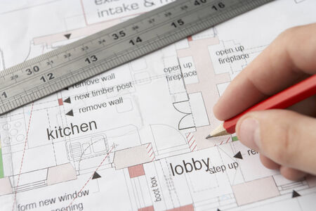 Man working on technical drawing Standard-Bild