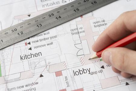 refurbishing: Man working on technical drawing Stock Photo