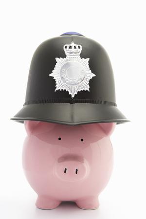 Piggybank with policemans helmet