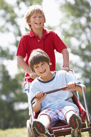 10 years old: Young boys playing with go-kart Stock Photo