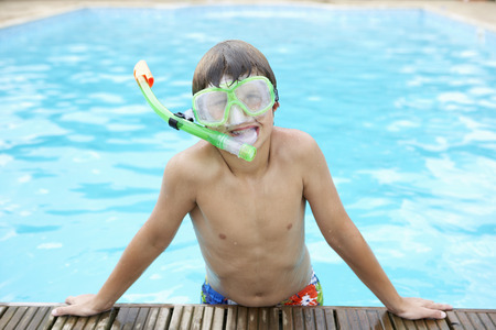 Boy in outdoor swimming pool