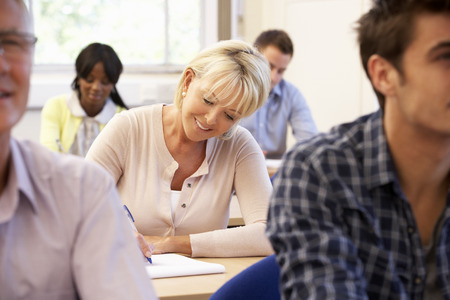 adult learning: Senior student in class Stock Photo