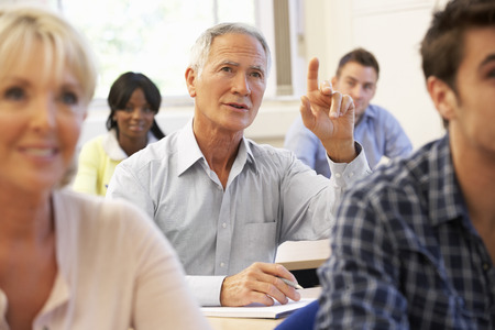 higher learning: Senior student in class Stock Photo