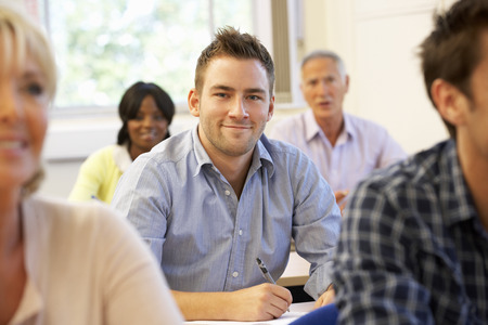 adult: Student in class Stock Photo
