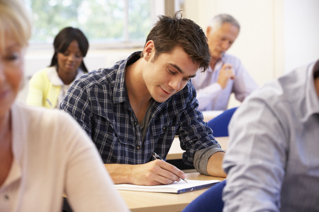 coursework: Student in class Stock Photo