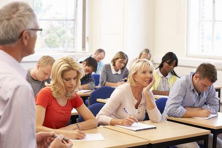 further education: Senior tutor teaching class
