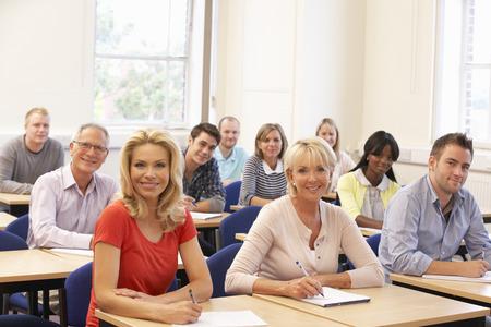 Mixed group of students in class Stock Photo - 33603699