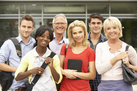 Mixed group of students outside college Stock Photo