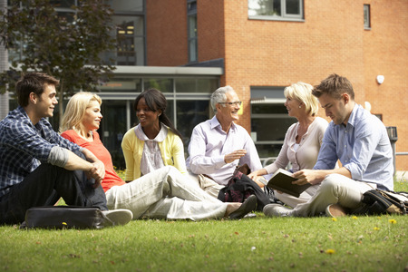 younger: Mixed group of students outside college Stock Photo