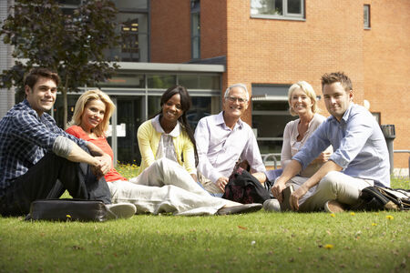 Mixed group of students outside college photo