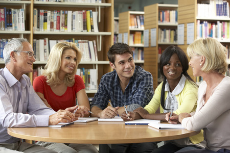 younger: Mixed group of students in library