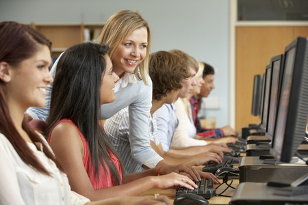Students working on computers in library photo